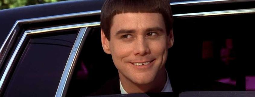 Jim Carrey from Dumb & Dumber poking head out of limo window
