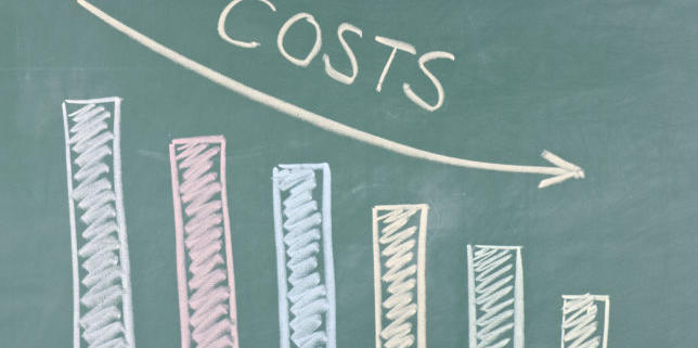 chalkboard graph of decreasing costs