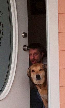 Brian Carter in doorway behind Brad the dog